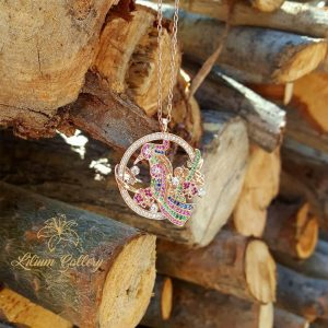 Women's gold pendant woodpecker